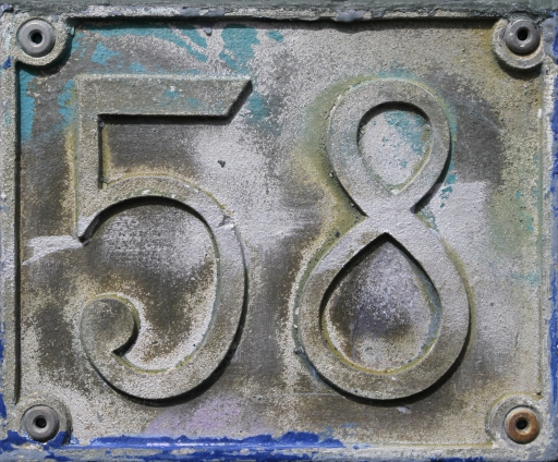 metal number sign 58 fifty eight cut pattern door house mark four edges two digits old damaged weathered texture