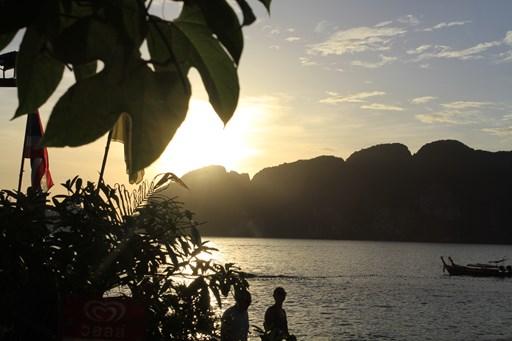 sun-down-mountains-ocean-thailand-phi-islands-boats-tree-foliage-people-walk-on-beach-evening-sky-dark-beautiful-stock-photo.jpg